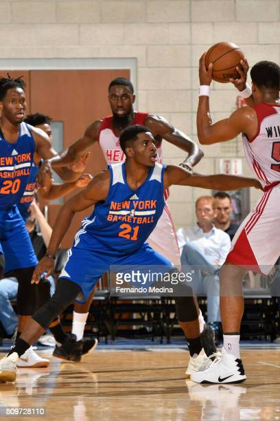 Damyean Dotson of the New York Knicks plays defense against the Miami Heat during the Mountain Dew Orlando Pro Summer League on July 6 2017 at Amway...