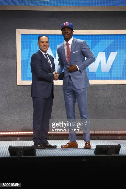 Damyean Dotson shakes hands with Deputy Commissioner Mark Tatum after being selected number forty fourth overall by the New York Knicks during the...