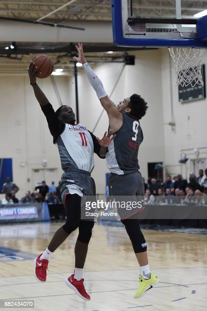 Damyean Dotson works against Dillon Brooks during Day Two of the NBA Draft Combine at Quest MultiSport Complex on May 12 2017 in Chicago Illinois...