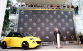 Dan Akerson CEO of General Motors speaks next to an Opel car 'Adam' during a press conference at Opel headquarters on April 10 2013 in Ruesselsheim...