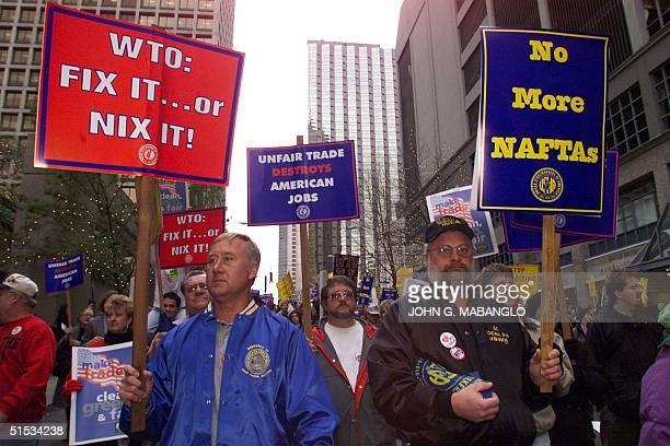 Dan Albritton and Al Skinner of the Steel workers of US AFLCIO Union march downtown Seattle Washington with other antiWorld Trade Organzation...