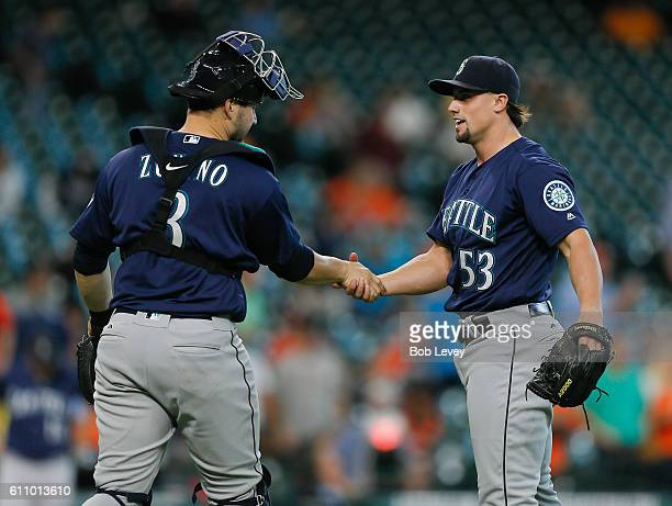 Dan Altavilla of the Seattle Mariners shakes hands with Mike Zunino after the final out against the Houston Astros at Minute Maid Park on September...