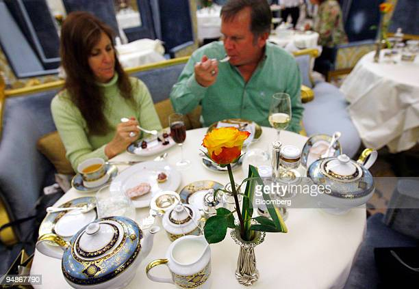 Dan and Vicky Garske from Santa Barbara California dine on pastries during tea service in the Palm Court at the Plaza Hotel in New York US on Monday...