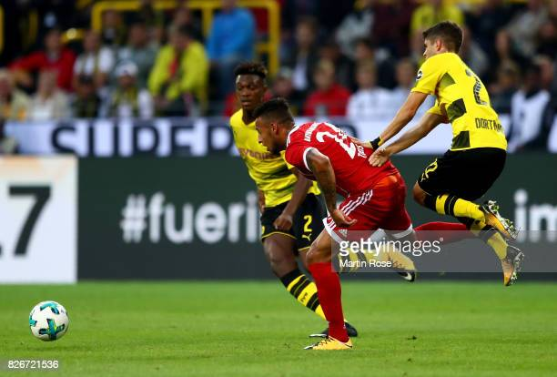 Dan Axel Zagadou of Dortmund and Corentin Tolisso of Muenchen battle for the ball during the DFL Supercup 2017 match between Borussia Dortmund and...