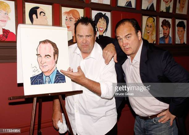 Dan Aykroyd and Jim Belushi pose as he gets his carucature unveiled in honor of his performance in 'Born Yesterday' on Broadway at Sardis on June 25...