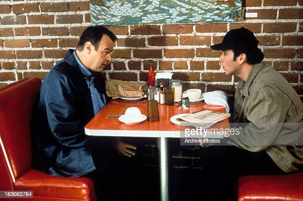 Dan Aykroyd sits down with John Cusack in a scene from the film 'Grosse Pointe Blank' 1997