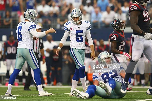 Dan Bailey of the Dallas Cowboys and Chris Jones celebrate the game winning field goal against the Houston Texans in overtime at ATT Stadium on...