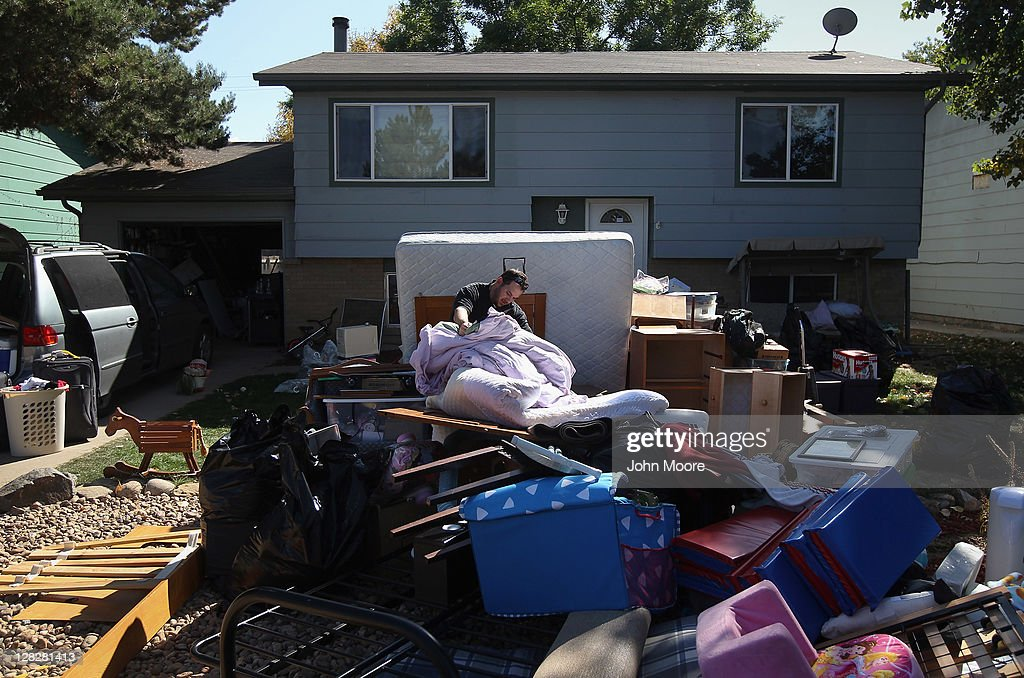 Dan Barbiere searches through his household possessions after they were removed by an eviction team during a home foreclosure on October 5, 2011 in Milliken, Colorado. His wife Brandie said she had stopped making the mortgage payments 11 months before, after she lost more than half her home child care business due to the continued weak economy. A nationwide glut of foreclosed homes is expected to depress U.S. housing values for years.