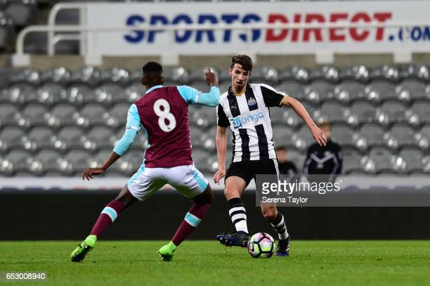 Dan Barlaser of Newcastle United passes the ball whilst Edimilson Fernandez of West Ham United attempt to intercept during the Premier League 2 Match...