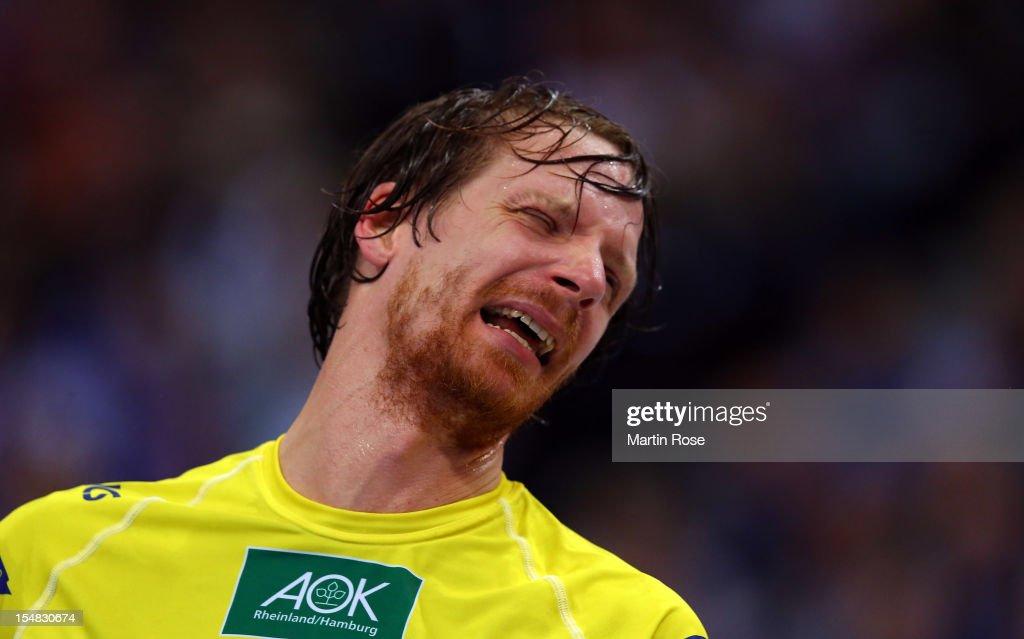 Dan Beutler, goalkeeper of Hamburg looks dejected after losing the DKB Handball Bundesliga match between HSV Hamburg and THW Kiel at the O2 World on October 27, 2012 in Hamburg, Germany.