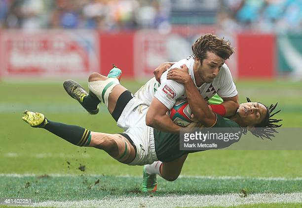 Dan Bibby of England is tackled by Justin Geduld of South Africa during the Cup quarterfinal match between England and South Africa on day three of...