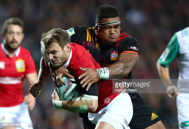 Dan Biggar of the Lions is tackled by Siegfried Fisi'ihoi of the Chiefs during the 2017 British Irish Lions tour match between the Chiefs and the...