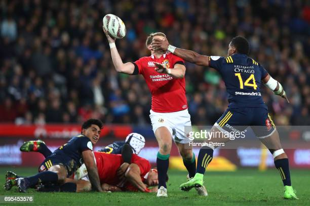 Dan Biggar of the Lions is tackled high by Waisake Naholo of the Highlanders as he offloads during the 2017 British Irish Lions tour match between...