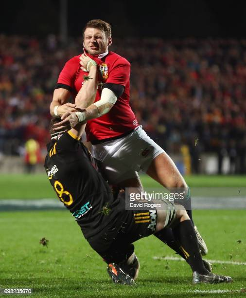 Dan Biggar of the Lions tackles Tom Sanders of the Chiefs during the 2017 British Irish Lions tour match between the Chiefs and the British Irish...