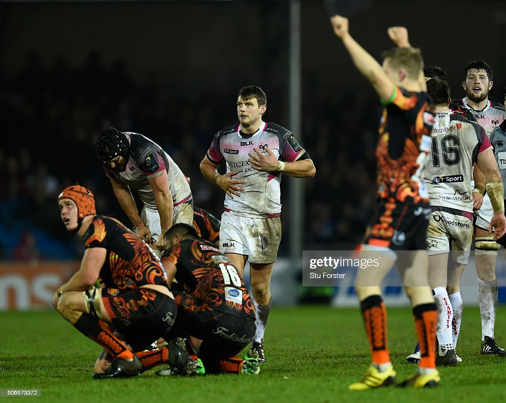 Dan Biggar of the Ospreys reacts as the Chiefs celebrate on the final whistle during the European Rugby Champions Cup match between Exeter Chiefs and...