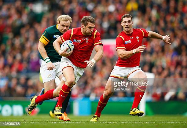 Dan Biggar of Wales breaks to set up the first Wales try watched by George North of Wales during the 2015 Rugby World Cup Quarter Final match between...