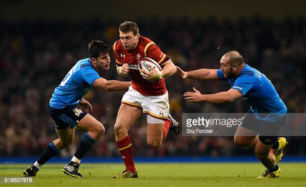 Dan Biggar of Wales bursts through the Italy defence to score his team'ssecond try during the RBS Six Nations match between Wales and Italy at the...