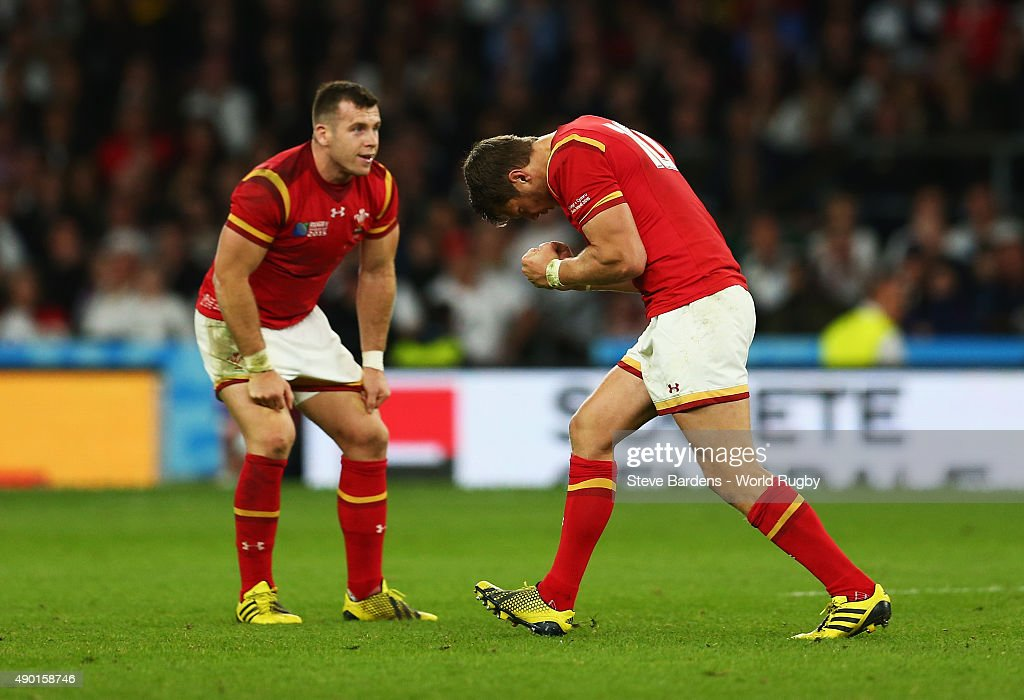 Dan Biggar of Wales celebrates kicking the winning penalty with Gareth Davies of Wales during the 2015 Rugby World Cup Pool A match between England...