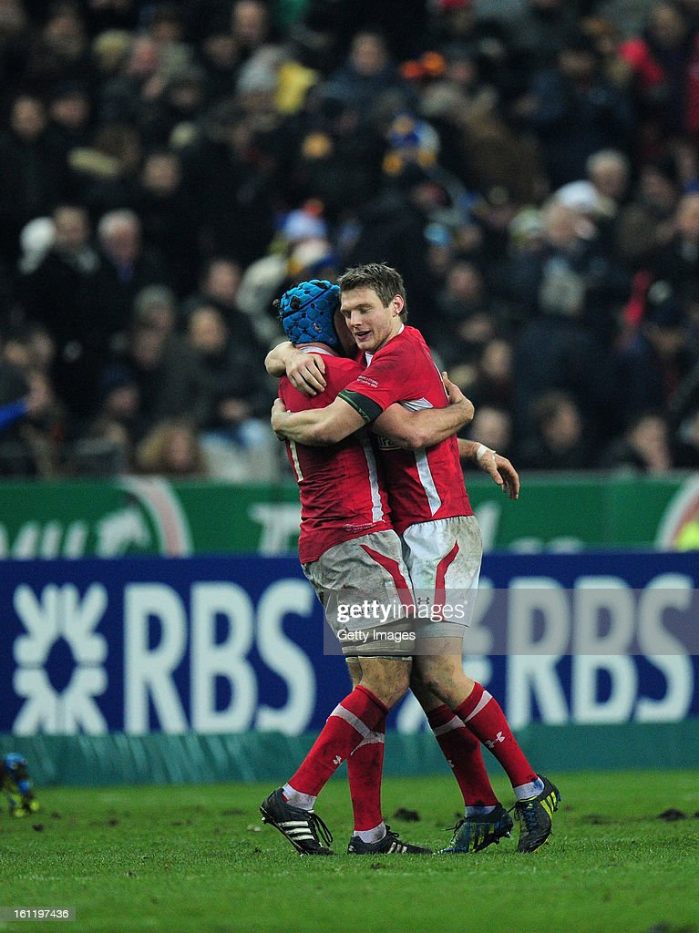 Dan Biggar (R) of Wales celebrates with Justin Tipuric after the RBS Six Nations match between France and Wales at Stade de France on February 9, 2013 in Paris, France.