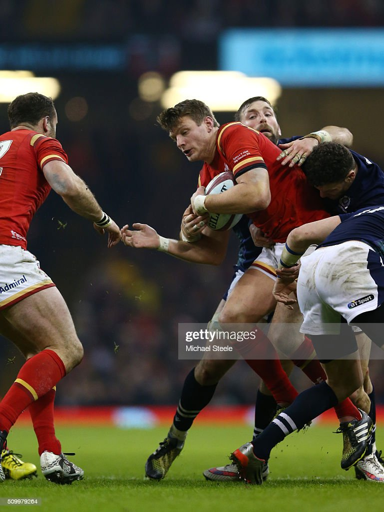 <a gi-track='captionPersonalityLinkClicked' href=/galleries/search?phrase=Dan+Biggar&family=editorial&specificpeople=5607224 ng-click='$event.stopPropagation()'>Dan Biggar</a> of Wales gets support from teammate <a gi-track='captionPersonalityLinkClicked' href=/galleries/search?phrase=Jamie+Roberts&family=editorial&specificpeople=3530992 ng-click='$event.stopPropagation()'>Jamie Roberts</a> as he is wrapped up by the Scotland defence during the RBS Six Nations match between Wales and Scotland at the Principality Stadium on February 13, 2016 in Cardiff, Wales.