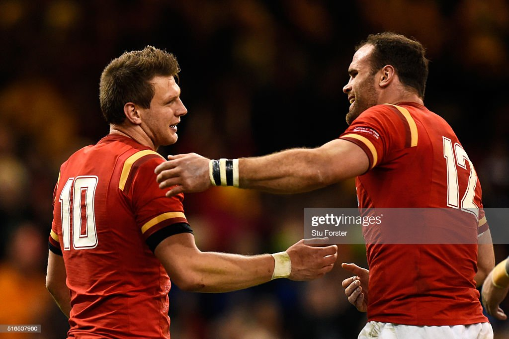 Dan Biggar of Wales is congratulated by teammate Jamie Roberts after scoring his team's second try during the RBS Six Nations match between Wales and...