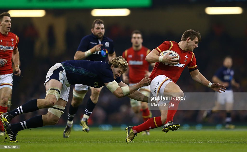 <a gi-track='captionPersonalityLinkClicked' href=/galleries/search?phrase=Dan+Biggar&family=editorial&specificpeople=5607224 ng-click='$event.stopPropagation()'>Dan Biggar</a> of Wales is rackled by Richie Gray of Scotland during the RBS Six Nations match between Wales and Scotland at the Principality Stadium on February 13, 2016 in Cardiff, Wales.