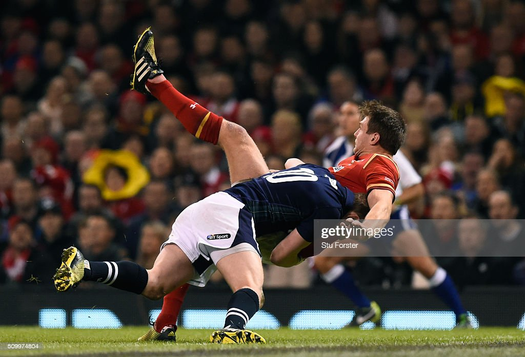 <a gi-track='captionPersonalityLinkClicked' href=/galleries/search?phrase=Dan+Biggar&family=editorial&specificpeople=5607224 ng-click='$event.stopPropagation()'>Dan Biggar</a> of Wales is tackled by <a gi-track='captionPersonalityLinkClicked' href=/galleries/search?phrase=Finn+Russell&family=editorial&specificpeople=9193124 ng-click='$event.stopPropagation()'>Finn Russell</a> of Scotland during the RBS Six Nations match between Wales and Scotland at the Principality Stadium on February 13, 2016 in Cardiff, Wales.