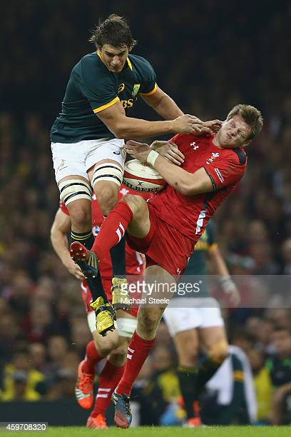 Dan Biggar of Wales is taken out by Eben Etzebeth of South Africa after claiming a high ball during the International match betwwen Wales and South...