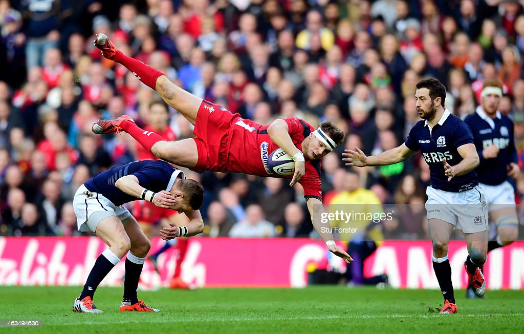 Dan Biggar of Wales is taken out in the air by Finn Russell of Scotland during the RBS Six Nations match between Scotland and Wales at Murrayfield...