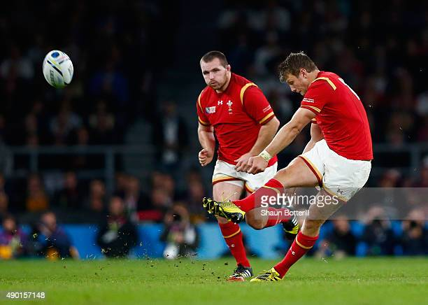 Dan Biggar of Wales kicks a penalty during the 2015 Rugby World Cup Pool A match between England and Wales at Twickenham Stadium on September 26 2015...