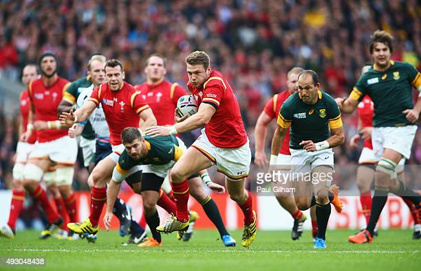 Dan Biggar of Wales makes a break during the 2015 Rugby World Cup Quarter Final match between South Africa and Wales at Twickenham Stadium on October...