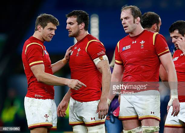 Dan Biggar of Wales talks to Sam Warburton as Alun Wyn Jones of Wales looks on after the 2015 Rugby World Cup Pool A match between Australia and...