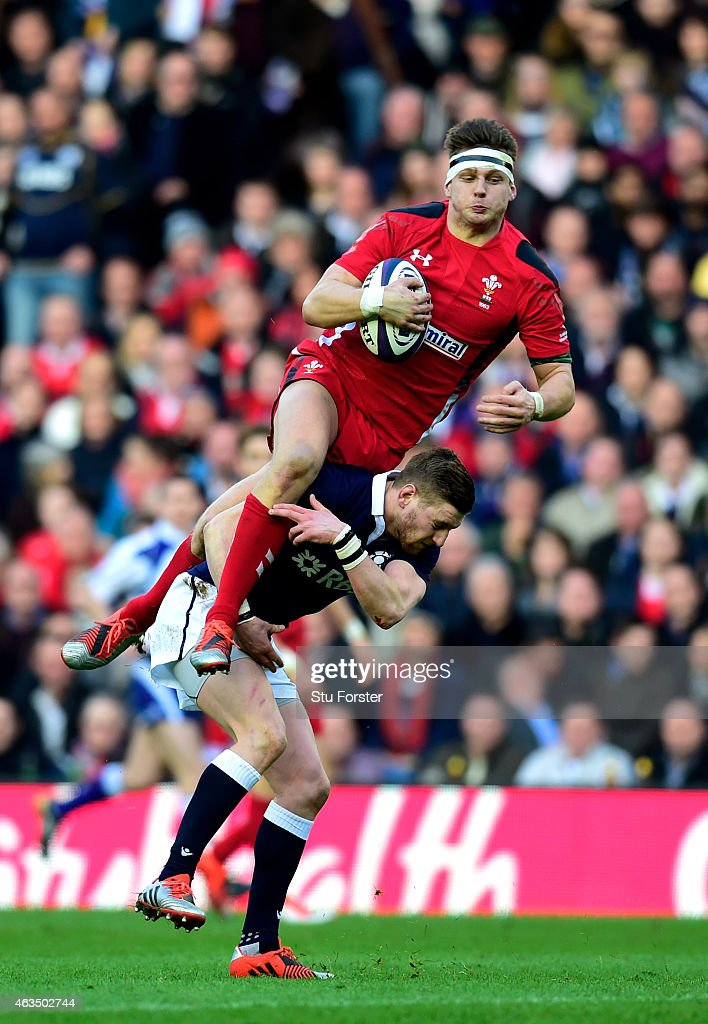 Dan Biggar of Walesis taken out in the air by Finn Russell of Scotland during the RBS Six Nations match between Scotland and Wales at Murrayfield...