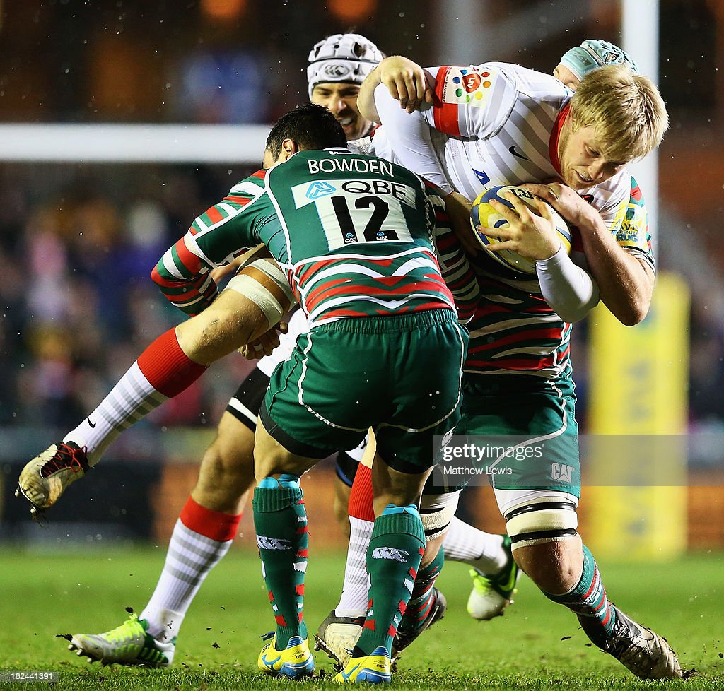 Dan Bowden of Leicester tackles Jackson Wray of Saracens during the Aviva Premiership match between Leicester Tigers and Saracens at Welford Road on February 23, 2013 in Leicester, England.