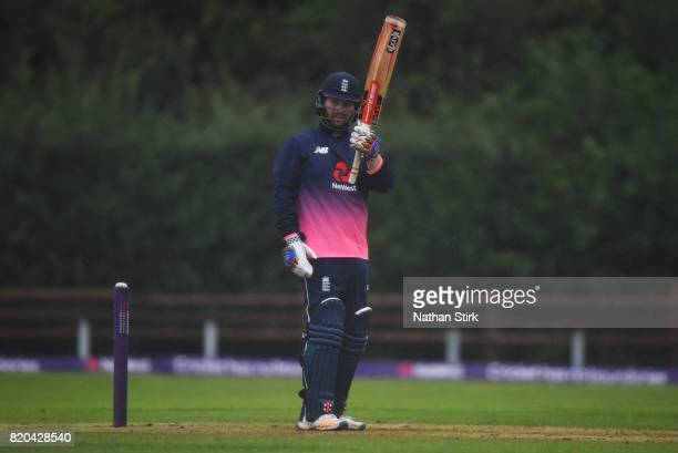 Dan Bowser of England raises his bat after scoring 50 runs during the INAS Learning Disability TriSeries Trophy Final match between England and South...