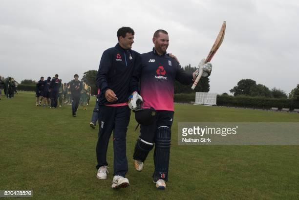 Dan Bowser of England walks of the pitch with Alex Jervis during the INAS Learning Disability TriSeries Trophy Final match between England and South...