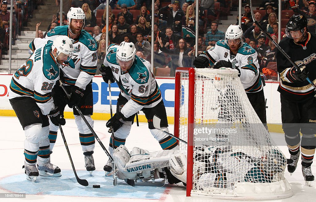 Dan Boyle #22, Joe Thornton #19, Matt Irwin #52 and Antti Niemi #31 of the San Jose Sharks help stop the puck as teammate Martin Havlat #9 and Bobby Ryan #9 of the Anaheim Ducks look on during the game on March 25, 2013 at Honda Center in Anaheim, California.