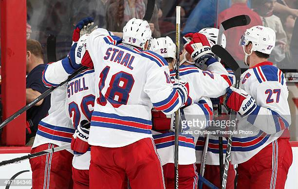 Dan Boyle of the New York Rangers celebrate his game winning shootout goal against the Ottawa Senators with team mates Marc StaalJarret Stoll and...