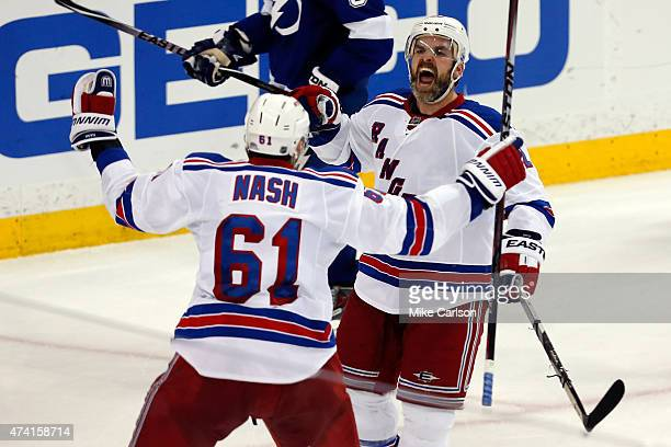 Dan Boyle of the New York Rangers celebrates with teammate Rick Nash after scoring a goal to tie the game up late in the third period against Ben...
