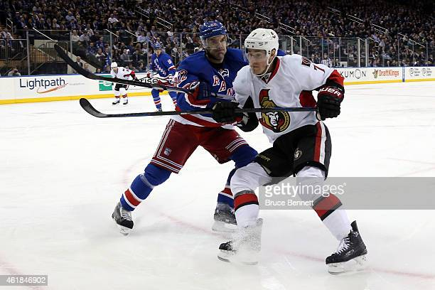 Dan Boyle of the New York Rangers checks Kyle Turris of the Ottawa Senators in the first period during their game at Madison Square Garden on January...