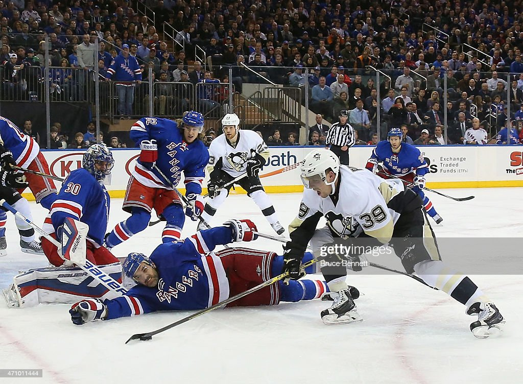 Dan Boyle of the New York Rangers defends against David Perron of the Pittsburgh Penguins during the third period in Game Five of the Eastern...
