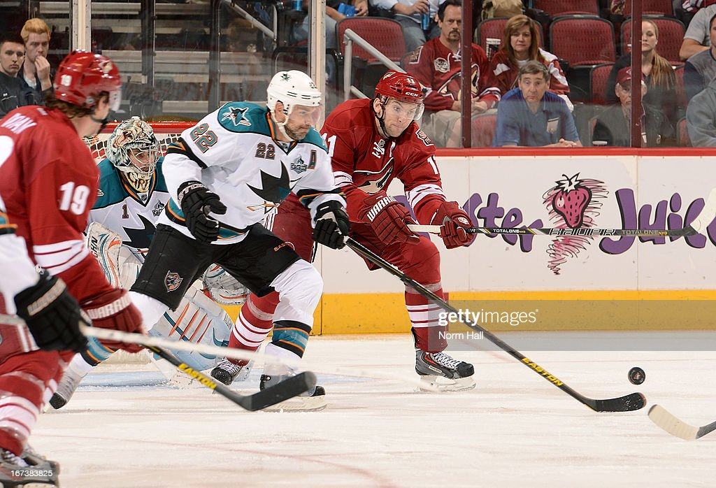<a gi-track='captionPersonalityLinkClicked' href=/galleries/search?phrase=Dan+Boyle&family=editorial&specificpeople=201502 ng-click='$event.stopPropagation()'>Dan Boyle</a> #22 of the San Jose Sharks and <a gi-track='captionPersonalityLinkClicked' href=/galleries/search?phrase=Martin+Hanzal&family=editorial&specificpeople=2109469 ng-click='$event.stopPropagation()'>Martin Hanzal</a> #11 of the Phoenix Coyotes battle for a loose puck in front of the net during the third period at Jobing.com Arena on April 24, 2013 in Glendale, Arizona.