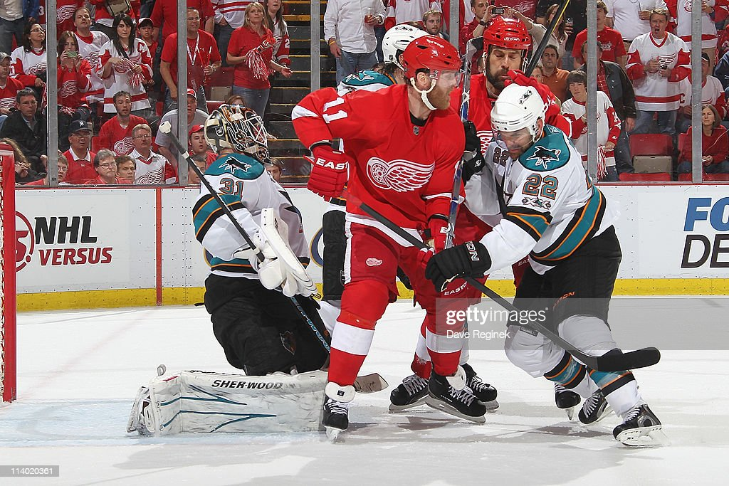 Dan Boyle #22 of the San Jose Sharks and teammate Doug Murray #3 defend Danny Cleary #11 of the Detroit Red Wings and teammate Todd Bertuzzi #44 while Antti Niemi #31 of the Sharks tends the net during Game Six of the Western Conference Semifinals of the 2011 NHL Stanley Cup Playoffs at Joe Louis Arena on May 10, 2011 in Detroit, Michigan. The Detroit Red Wings defeated the San Jose Sharks 3-1.