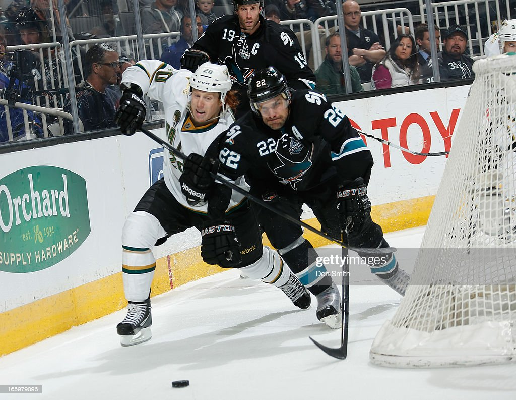 <a gi-track='captionPersonalityLinkClicked' href=/galleries/search?phrase=Dan+Boyle&family=editorial&specificpeople=201502 ng-click='$event.stopPropagation()'>Dan Boyle</a> #22 of the San Jose Sharks battles for the puck against <a gi-track='captionPersonalityLinkClicked' href=/galleries/search?phrase=Cody+Eakin&family=editorial&specificpeople=5662792 ng-click='$event.stopPropagation()'>Cody Eakin</a> #20 of the Dallas Stars during an NHL game on April 7, 2013 at HP Pavilion in San Jose, California.