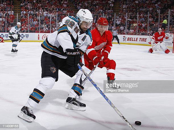 Dan Boyle of the San Jose Sharks battles for the puck with Brian Rafalski of the Detroit Red Wings in Game Six of the Western Conference Semifinals...