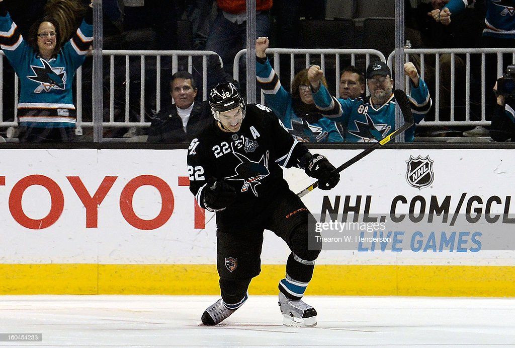 Dan Boyle #22 of the San Jose Sharks celebrates after he got the winning shot by goalkeeper Devan Dubnyk #40 of the Edmonton Oilers to win the game 3-2 in an over time shoot-out at HP Pavilion on January 31, 2013 in San Jose, California.