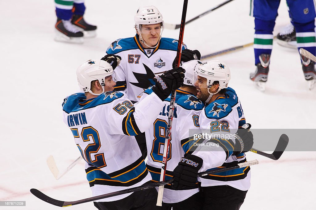 Dan Boyle #22 of the San Jose Sharks celebrates his third period goal with teammates Tommy Wingels #57, Matt Irwin #52 and Joe Pavelski #8 during their game against the Vancouver Canucks in Game One of the Western Conference Quarterfinals during the 2013 NHL Stanley Cup Playoffs at Rogers Arena on May 1, 2013 in Vancouver, British Columbia, Canada.