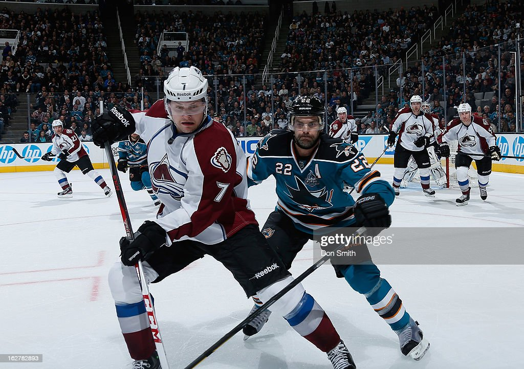 <a gi-track='captionPersonalityLinkClicked' href=/galleries/search?phrase=Dan+Boyle&family=editorial&specificpeople=201502 ng-click='$event.stopPropagation()'>Dan Boyle</a> #22 of the San Jose Sharks fights for the puck against John Mitchell #7 of the Colorado Avalanche during an NHL game on February 26, 2013 at HP Pavilion in San Jose, California.