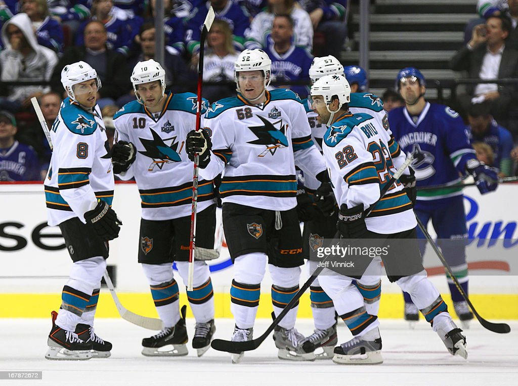 <a gi-track='captionPersonalityLinkClicked' href=/galleries/search?phrase=Dan+Boyle&family=editorial&specificpeople=201502 ng-click='$event.stopPropagation()'>Dan Boyle</a> #22 of the San Jose Sharks is congratulated by teammates after scoring against the Vancouver Canucks during Game One of the Western Conference Quarterfinals during the 2013 NHL Stanley Cup Playoffs at Rogers Arena on May 1, 2013 in Vancouver, British Columbia, Canada. San Jose won 3-1.