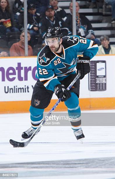 Dan Boyle of the San Jose Sharks looks to pass the puck during an NHL game against the Edmonton Oilers on February 17 2009 at HP Pavilion at San Jose...